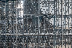 Complicated scaffolding consisting of many poles and struts inside a historic building royalty free stock photography
