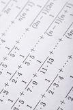 Complicated science expressions. In math reference book Stock Photos