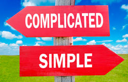 Complicated or simple. Complicated and simple choice showing strategy change or dilemmas royalty free stock images