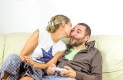 Complicity couple play video games sofa Stock Photos