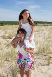 Complicity between a mother and her daughter at the beach. Happy family mother and daughter have fun stock photos