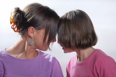 Complicity between sisters. The complicity between two sisters royalty free stock images