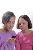 Complicity between sisters. With music player stock image