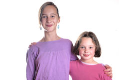 Complicity between sisters. On a white background royalty free stock images