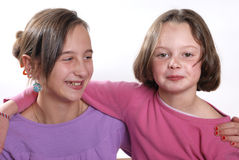 Complicity between sisters. On a white background stock photo