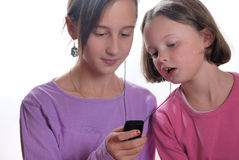 Complicity between sisters. With music player royalty free stock images