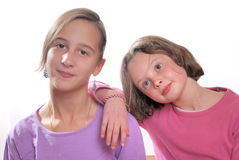 Complicity between sisters. Complicity between two young sisters royalty free stock photos