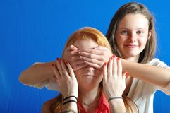Complicity between two teens. Hello, guess who I am stock images