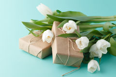 Compliment gift with spring white tulips Royalty Free Stock Photography