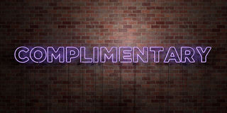 COMPLIMENTARY - fluorescent Neon tube Sign on brickwork - Front view - 3D rendered royalty free stock picture. Can be used for online banner ads and direct vector illustration
