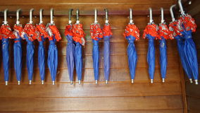 Complimentary lending Blue and red colour umbrella rail Royalty Free Stock Image