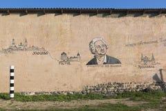 Complot de dessin de l'itinéraire de Lomonosov d'Arkhangelsk vers Moscou sur le mur d'un bâtiment dans le village de Verkhovazhye Photos stock