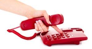 Componendo sul telefono rosso Fotografie Stock