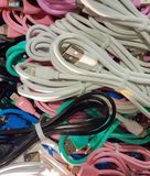 A bunch of colored wires for different phones royalty free stock images