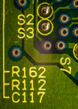Component markings on pcb. Macro shot of component markings on pcb Royalty Free Stock Photo