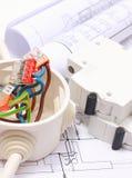 Componenti per le installazioni ed i diagrammi elettrici della costruzione Immagini Stock
