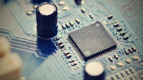 Components on board. PCB to PC. Chip, capacitor and connectors on the motherboard of a personal computer. Modern technological bac Royalty Free Stock Photography