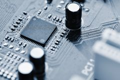 Components on board. PCB to PC. Chip, capacitor and connectors on the motherboard of a personal computer. Modern technological bac Stock Image