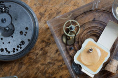 Components of a clock on a watchmakers workbench Royalty Free Stock Photos