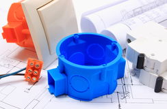 Components for electrical installations and rolls of diagrams Royalty Free Stock Image
