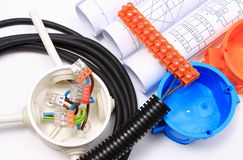 Components for electrical installations and rolls of diagrams Royalty Free Stock Photos
