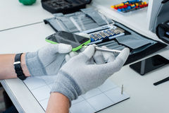 Components inside of mobile phone. Close-up photos showing process of mobile phone repair royalty free stock photo