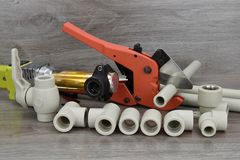 Components making water pipes. Tools for doing waterworks. Royalty Free Stock Photography