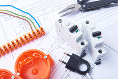 Components for use in electrical installations. Fuses, plug, connectors, junction box, switch, isolation tape   and wires. Accesso Stock Image