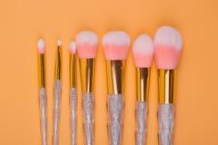 Componga los cepillos aisló el fondo en colores pastel Imagen de archivo