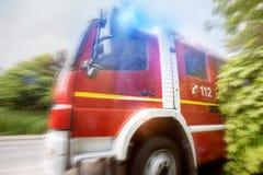 Comporre di velocità del camion del pompiere immagini stock libere da diritti