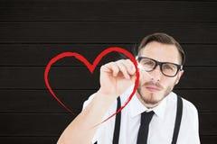 Composé de Digital d'homme de ballot dessinant un coeur rouge Photos libres de droits