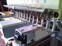 Composants de la machine de broderie Photo stock