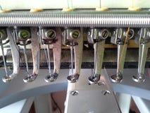 Composants de la machine de broderie Photographie stock