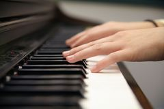 Compose 2. Womans hands playing on the keys of an electric piano Stock Photography