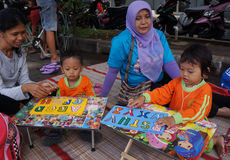Compose letter. Kindergarten students learn to compose letters in the city of Solo, Central Java, Indonesia royalty free stock photography