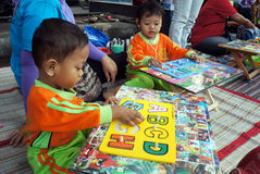 Compose letter. Kindergarten students learn to compose letters in the city of Solo, Central Java, Indonesia royalty free stock photo