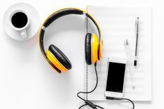 Compose music. Headphones, music notes, phone and coffee on white background top view copyspace. Compose music. Headphones, music notes, phone and coffee on royalty free stock photography
