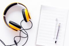 Compose music. Headphones and music notes on white background top view.  stock photography