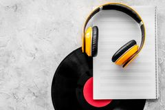 Compose music. Vinyl records, headphones, music notes on grey background top view copyspace. Compose music. Vinyl records, headphones, music notes on grey stock image