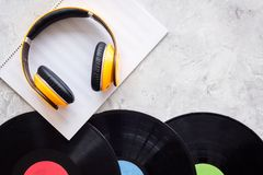 Compose music. Vinyl records, headphones, music notes on grey background top view copyspace. Compose music. Vinyl records, headphones, music notes on grey royalty free stock photo