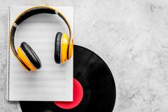Compose music. Vinyl records, headphones, music notes on grey background top view copyspace. Compose music. Vinyl records, headphones, music notes on grey stock photo