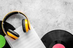 Compose music. Vinyl records, headphones, music notes on grey background top view copyspace. Compose music. Vinyl records, headphones, music notes on grey stock photos