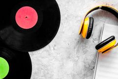 Compose music. Vinyl records, headphones, music notes on grey background top view copyspace. Compose music. Vinyl records, headphones, music notes on grey royalty free stock images