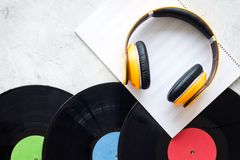 Compose music. Vinyl records, headphones, music notes on grey background top view copyspace. Compose music. Vinyl records, headphones, music notes on grey royalty free stock image
