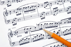 Compose the song on a music sheet. With a pencil Stock Image