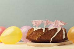 Delicious cake decorated with pink flags Royalty Free Stock Photo