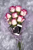 Composed of the roses and mobile phone adn chalkboard heart stock photography