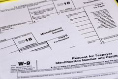 Shot of IRS tax forms 1099-M, 1099-K and W-9 stock images
