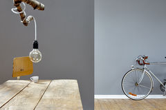 Composed vintage atelier table branch and silver road bike Royalty Free Stock Photography