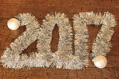 Is composed of the words `2017`. Of tinsel and Christmas balls Stock Image